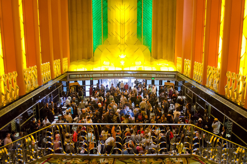 Attendees crowd lobby post lecture. KALW Presents Tavis Smiley & Cornel West, Paramount Theatre, 2025 Broadway, Oakland, California.