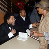 Cornel West and Tavis Smiley at book signing table. KALW Presents Tavis Smiley & Cornel West, Paramount Theatre, 2025 Broadway, Oakland, California.
