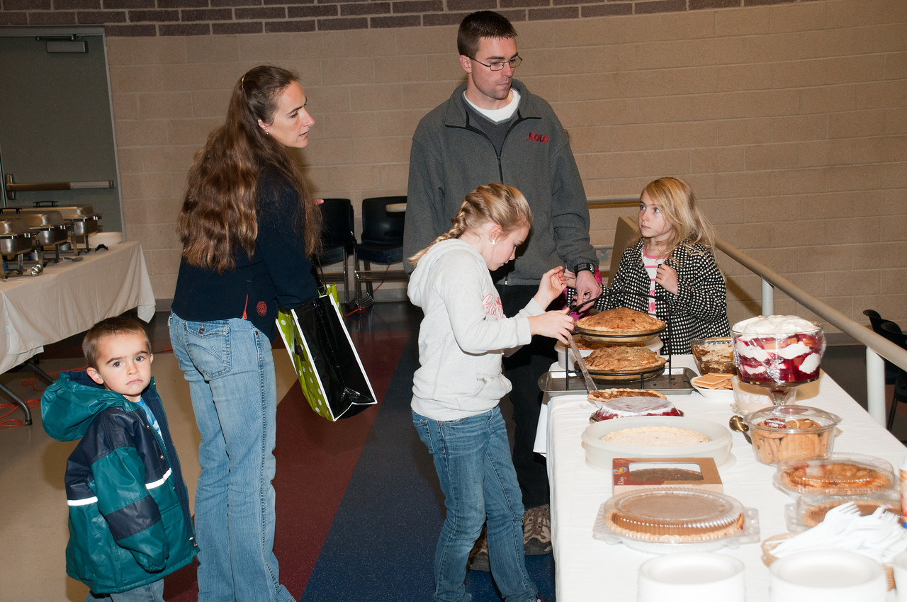 Patriot photos by Scott Weldon Nathan and Anne Harrlin and family bringing in their covered dish to the KASD Thanksgiving Community Potluck Dinner on Nov. 21.