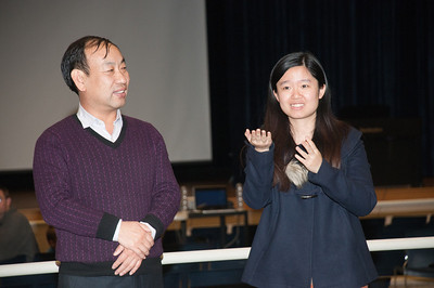 Principal Wang with Li Ziyan, a KU student, who interprets during the KASD Thanksgiving Community Potluck Dinner on Nov. 21.