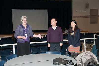 Patriot photos by Scott Weldon  KASD superintendent Kathy Metrick introduces Wang Zhaotang and Li Ziyan to those in attendance at the KASD Thanksgiving Community Potluck Dinner on Nov. 21.
