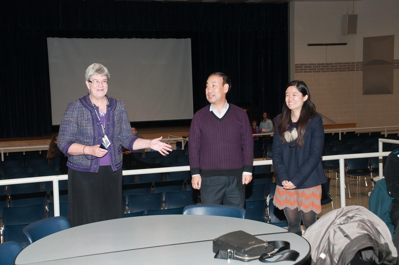 Patriot photos by Scott Weldon  KASD superintendent Kathy Metrick introduces Wang Zhaotang and Li Ziyan to those in attendance at the KASD Thanksgiving Community Potluck Dinner on Nov. 21.