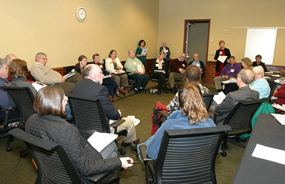 As groups gathered in the afternoon by faith tradition, Karen Clifton, standing right, executive director of the Catholic Mobilizing Network To End The Use Of The Death Penalty, Washington, D.C., leads a discussion among Catholics in attendance.  (Page 17, November 25, 2010 issue)