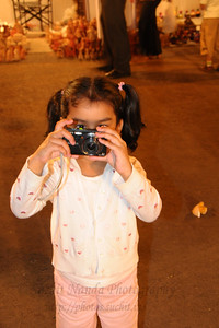 Charming young girl being helped with her Dad and Mom to take pictures of the Kala Ghoda Arts Festival held for nine days annually in February at Kala Ghoda, Mumbai. This year it was held from 7th February to 15th February 2009.