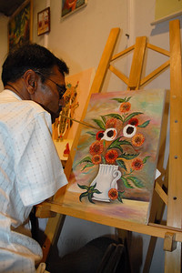 Artists Without Hands at work. Manji L. Ramani painting with his mouth.  Special skilled artist live at the Kala Ghoda Arts Festival, Feb 2007.  Manji is a member of MFPA (Indian Mouth & Food Painting Artists).