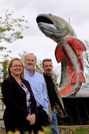 Record-Eagle/Jan-Michael Stump<br /> From left, Kalkaska village manager Penny Hill, brownfield redevelopment authority chair Mark Avery and village president Jeff Sieting stand near the village's iconic trout statue, which cold become part of a park or square as part of plans to redevelop the downtown area.
