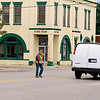 Record-Eagle/Jan-Michael Stump<br /> Debbie Nolan of Grayling crosses U.S. 131 after a dentist appointment in downtown Kalkaska. The road divides downtown and sees around 19,000 vehicles a day, a challenge for officials looking to redevelop the village.