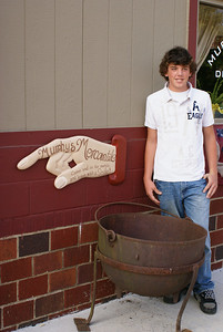 Portia Murphy's son Jodie and the custom sign for Murphy's Mercantile