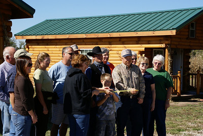 Ribbon cutting ceremony for the opening of the 4 log cabin guest houses at the Stone Barn Mercantile