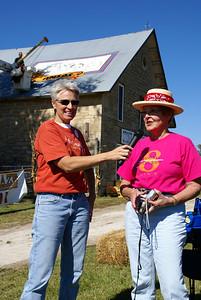 Sally Hatcher, president of the Kansas Barn Alliance explaining the logo project.