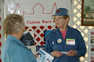 Kansas Barn Alliance president Sally Hatcher (right), explaining the purpose of the alliance to a visitor