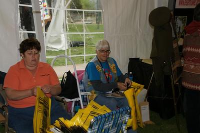 Volunteers preparing handout sacks with Abilene information