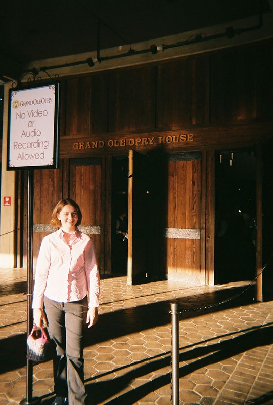 It is Tuesday Evening, about 45 minutes before the curtain goes up.  Katie is in front of the Grand Old Opry Hall entrance wearing her new blouse- an early birthday present thanks to Southwest Airlines