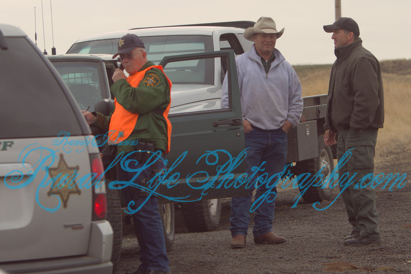 (Mr Bob Songer on left) along with other law enforcement officers play a key roll in traffic control when  the Cattle are brought across the valley.
