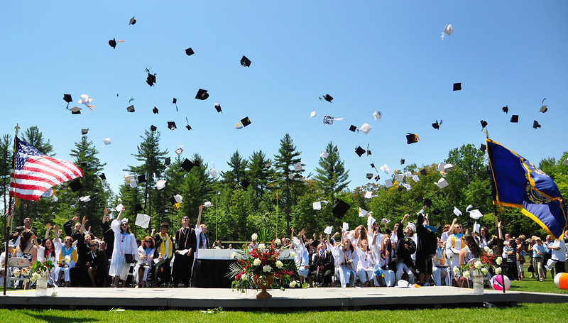 Kennett High School seniors throw their mortarboards aloft after receiving their diplomas during graduation ceremonies held on their North Conway, NH campus, at Gary Millen Stadium, on Saturday, June 19th, 2010.