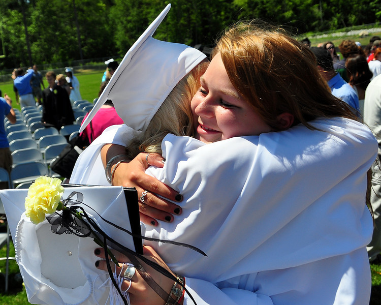 Two graduating seniors hug following graduation ceremonies at Kennett High School, in North Conway, NH, on Saturday, June 19th, 2010.