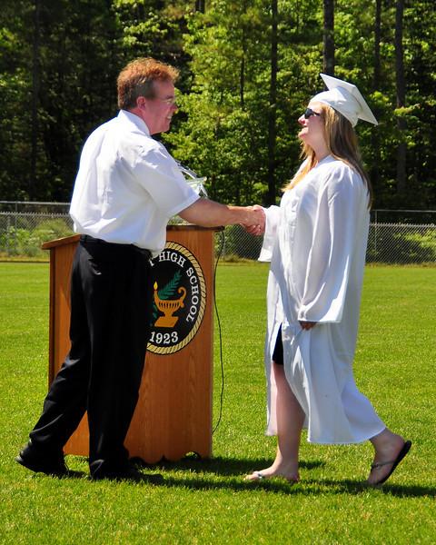 Kennett High School Principal Neil Moylan, presents an award to Ashley Buzzell, during graduation ceremonies held at Gary Millen Stadium, on Saturday, June 19th, 2010.