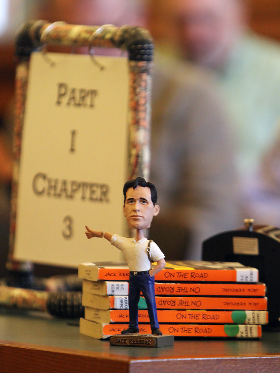 . Daylong reading of Jack Kerouac\'s On the Road begins at Pollard Memorial Library. Jack Kerouac bobblehead, and copies of On the Road. (SUN/Julia Malakie)