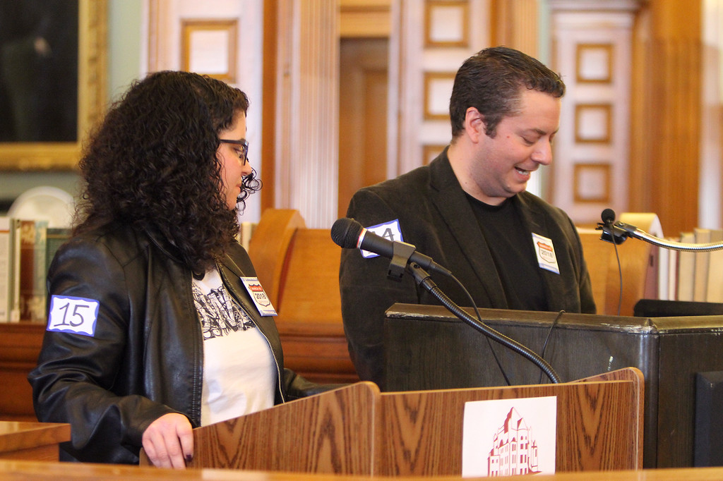 . Daylong reading of Jack Kerouac\'s On the Road begins at Pollard Memorial Library. James Ostis, right, president of Lowell Heritage Partnership, reading, and Jen Myers, resource development and communications manager at Coalition for a Better Acre, on deck. (SUN/Julia Malakie)