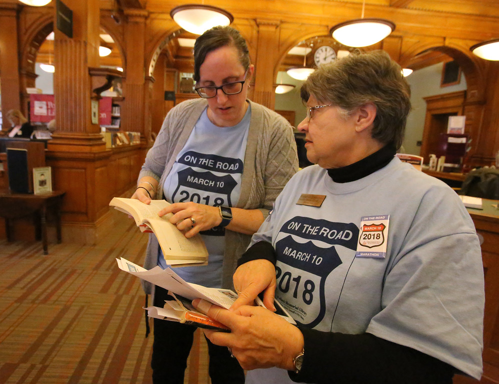 . Daylong reading of Jack Kerouac\'s On the Road begins at Pollard Memorial Library. Bridget Cooley of Dracut, left, who works at the Library, and Mary Johnson-Lally of Tyngsboro, former director of the Library, check the reading order. (SUN/Julia Malakie)