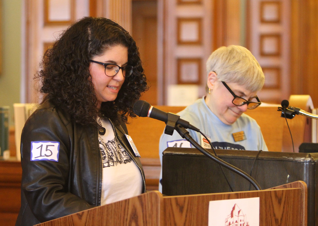 . Daylong reading of Jack Kerouac\'s On the Road begins at Pollard Memorial Library. Jen Myers, resource development and communications manager at Coalition for a Better Acre, left, reading, and Pollard Memorial Library Foundation board member Suzanne Dion, on deck. (SUN/Julia Malakie)