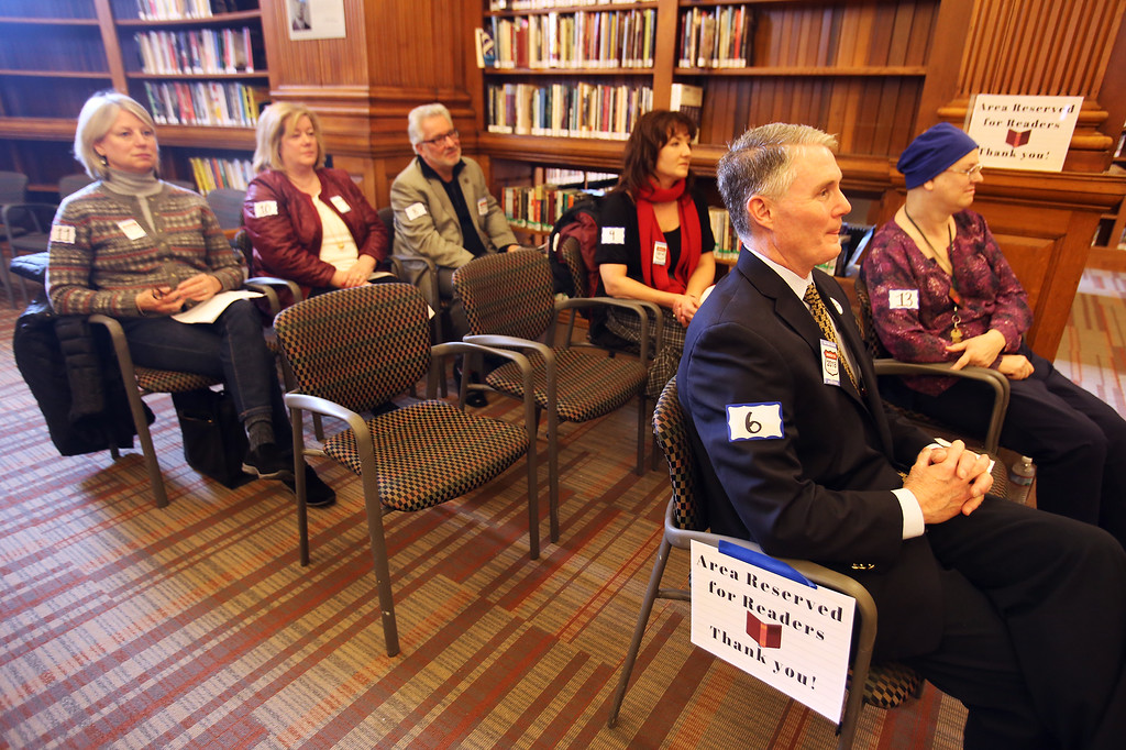 . Daylong reading of Jack Kerouac\'s On the Road begins at Pollard Memorial Library. Readers including city councilor Rodney Elliott, right front, and Library director Victoria Woodley, right rear. (SUN/Julia Malakie)