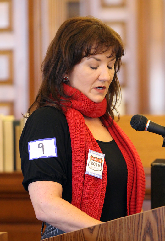 . Daylong reading of Jack Kerouac\'s On the Road begins at Pollard Memorial Library. Girls Inc. executive director Tracy Ingersoll reads. (SUN/Julia Malakie)