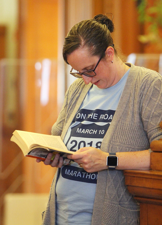 . Daylong reading of Jack Kerouac\'s On the Road begins at Pollard Memorial Library. Bridget Cooley of Dracut, who works at the Library, follows along. (SUN/Julia Malakie)