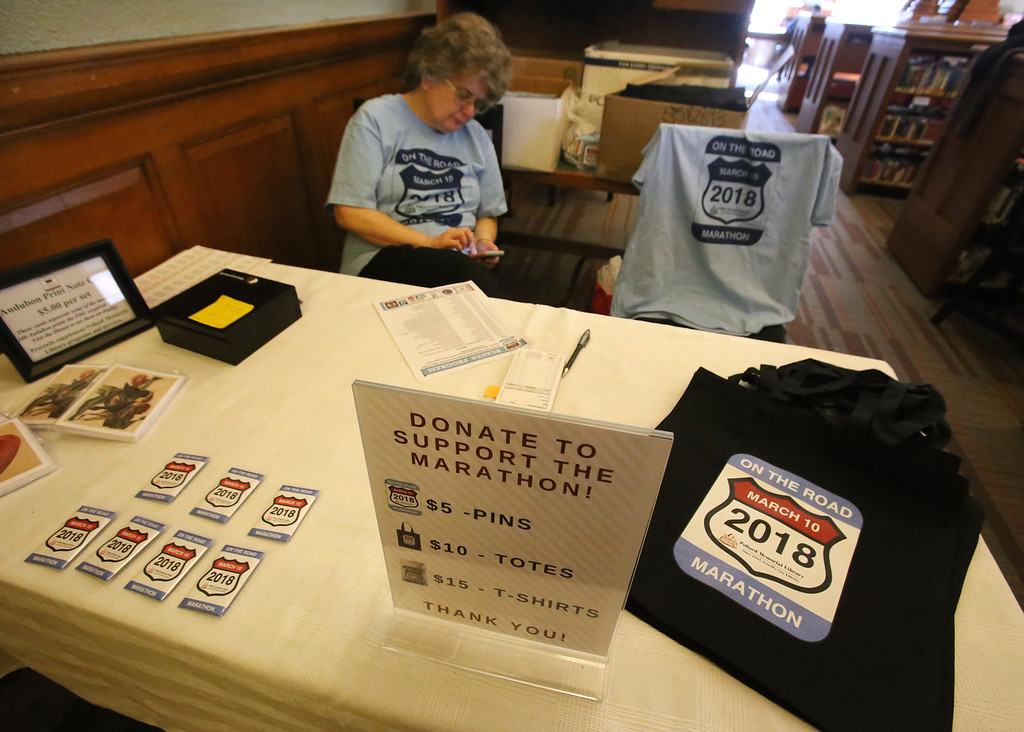 . Daylong reading of Jack Kerouac\'s On the Road begins at Pollard Memorial Library. Belinda Juran of Lowell, with items for sale to support the program. (SUN/Julia Malakie)