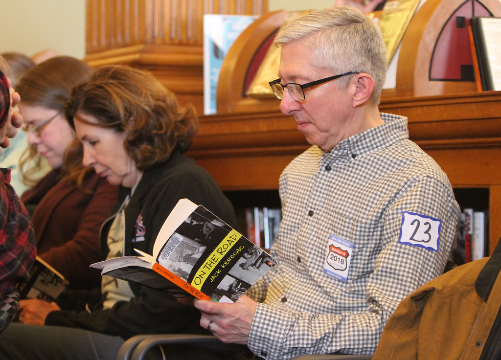 . Daylong reading of Jack Kerouac\'s On the Road begins at Pollard Memorial Library. Pollard Memorial Library Foundation board member Rosemany Noon, center, and Paul Brouillette of Somerville, a longtime Kerouac reader. (SUN/Julia Malakie)