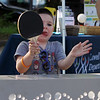 Opening ceremony and concert kicking off a more active Kerouac Park. Luke Graceffa, 4, of Lowell, tries out table tennis. (SUN/Julia Malakie)