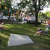 Opening ceremony and concert kicking off a more active Kerouac Park. From lef, brother Finlay, 11, Padraic, 8, and William Lamey, 4, with their parents Ryan and Allison Lamey, of Lowell, playing cornhole. (SUN/Julia Malakie)