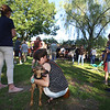 Opening ceremony and concert kicking off a more active Kerouac Park. Lauren Keisling of Lowell, center, with her six-month-old rescue puppy, Mara. (SUN/Julia Malakie)