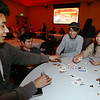"Khmer New Year's celebration at UMass Lowell's University Crossing.  From left, Ledan Somoeur, Sam Albert, Jonathan Vann, and UMass Amherst student Nova Chenda, all of Lowell, play ""Killer."" (SUN/Julia Malakie)"