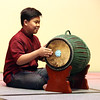 Khmer New Year's celebration at UMass Lowell's University Crossing. Dominic Vor, 12,of Lowell, plays the skor. (SUN/Julia Malakie)