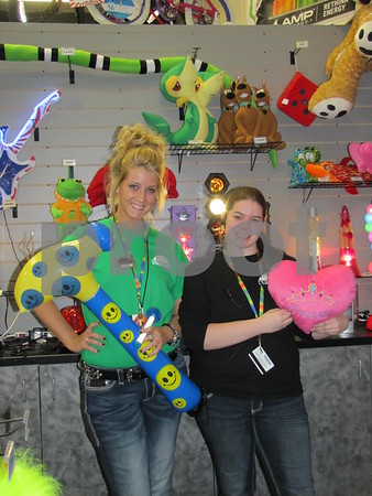 Laura Phillips, Team Leader at Fort Frenzy, and employee Kelsey Scott posed among some the prizes that can be won at Fort Frenzy.