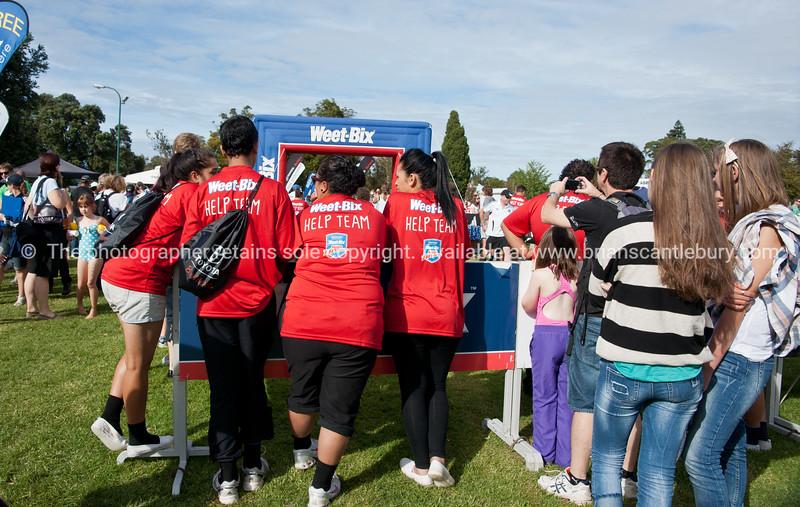 "Weetbix Kids Tryathlon, 2012,Tauranga's  Memorial Park.  Three helpers watch tohe finish line. The help team. ALSO SEE; <a href=""http://www.blurb.com/b/3811392-tauranga"">http://www.blurb.com/b/3811392-tauranga</a>"