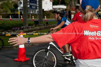 Weetbix Tryathlon at Tauranga's  Memorial Park.Helper shows the way. ALSO SEE; http://www.blurb.com/b/3811392-tauranga