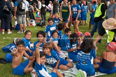 Weetbix Kids tryathalon, group in contestants tee shirts awaiting start call.Tauranga's  Memorial Park. ALSO SEE; http://www.blurb.com/b/3811392-tauranga