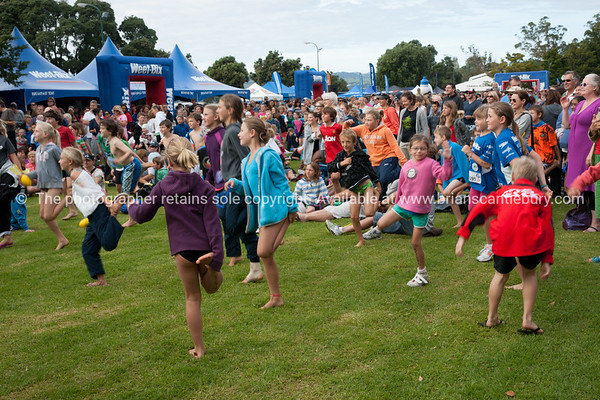 "Weetbix Kids Tryathlon, 2012, Tauranga's  Memorial Park. Kids doing warming up exercises. ALSO SEE; <a href=""http://www.blurb.com/b/3811392-tauranga"">http://www.blurb.com/b/3811392-tauranga</a>"