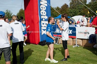 Weetbix Kids Tryathlon, 2012,Tauranga's  Memorial Park. Contestant receiving finishing medal. ALSO SEE; http://www.blurb.com/b/3811392-tauranga