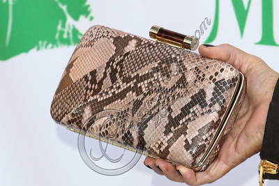 SANTA MONICA, CA - SEPTEMBER 25:  Television personality Kris Jenner (clutch detail) hosts the Midori Makeover Parlour at Fred Segal on September 25, 2012 in Santa Monica, California.  (Photo by Chelsea Lauren/WireImage)