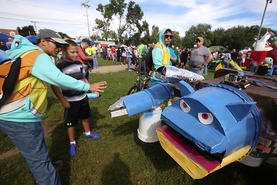 3rd annual Kinetic Sculpture Race entries enter the Merrimack River at the boat ramp and exit at Rynne Beach. Squirtle Squad team member Giancarlos Jaime-Guzman, 16, of Lawrence, explains the entry to Emanuel Robbins, 11, of Charleston. (SUN/Julia Malakie)