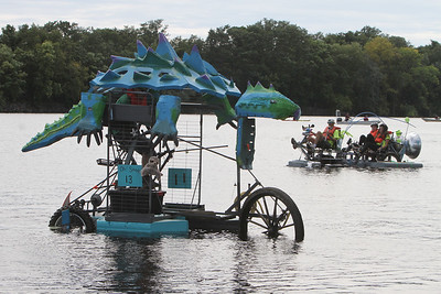 3rd annual Kinetic Sculpture Race entries enter the Merrimack River at the boat ramp and exit at Rynne Beach. Oh! Snap!, left, and Cosmic Cruiser, right. (SUN/Julia Malakie)