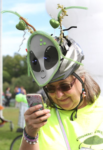 3rd annual Kinetic Sculpture Race entries enter the Merrimack River at the boat ramp and exit at Rynne Beach. Chrissy Theo Hungate, pit crew for the Cosmic Cruiser, sends pictures to her sister in NY.(SUN/Julia Malakie)