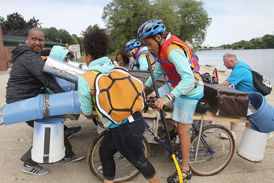 3rd annual Kinetic Sculpture Race entries enter the Merrimack River at the boat ramp and exit at Rynne Beach. Squirtle Squad lands. (SUN/Julia Malakie)