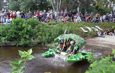 3rd annual Kinetic Sculpture Race entries enter the Merrimack River at the boat ramp and exit at Rynne Beach. STEM Academy enters the Merrimack River.(SUN/Julia Malakie)