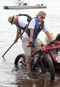 3rd annual Kinetic Sculpture Race entries enter the Merrimack River at the boat ramp and exit at Rynne Beach. Kerouac Attack Pack team John Pugh of Tyngsboro and Aileen Dashurova of Westford work on climbing up the bank at Rynne Beach. (SUN/Julia Malakie)