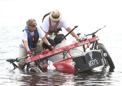 3rd annual Kinetic Sculpture Race entries enter the Merrimack River at the boat ramp and exit at Rynne Beach. Kerouac Attack Pack team members Aileen Dashurova of Westford and John Pugh of Tyngsboro land. (SUN/Julia Malakie)