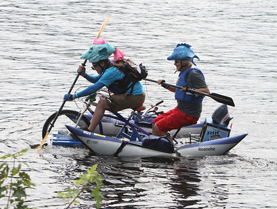 3rd annual Kinetic Sculpture Race entries enter the Merrimack River at the boat ramp and exit at Rynne Beach. Fish Heads gets underway. (SUN/Julia Malakie)